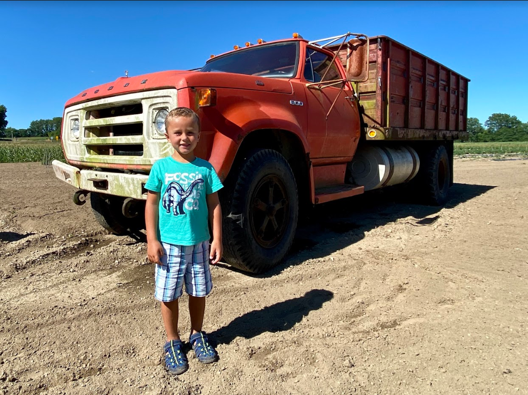 boy in front of truck