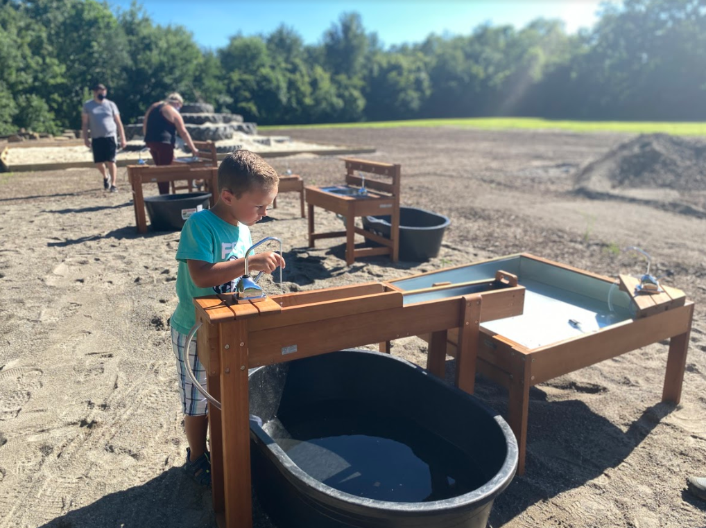 boy making mud pies