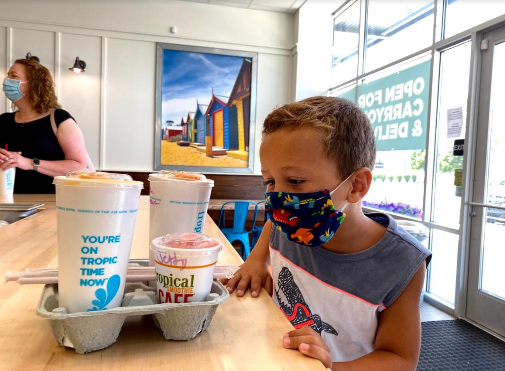 kid drinking smoothie