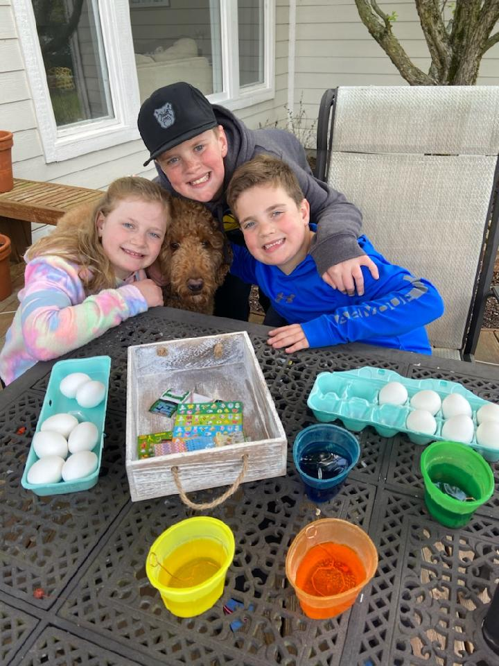 family coloring easter eggs