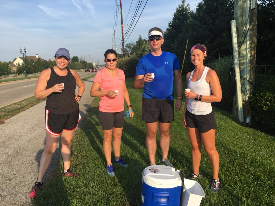 runners at aid station