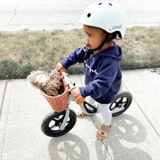 a kid sitting on a bike