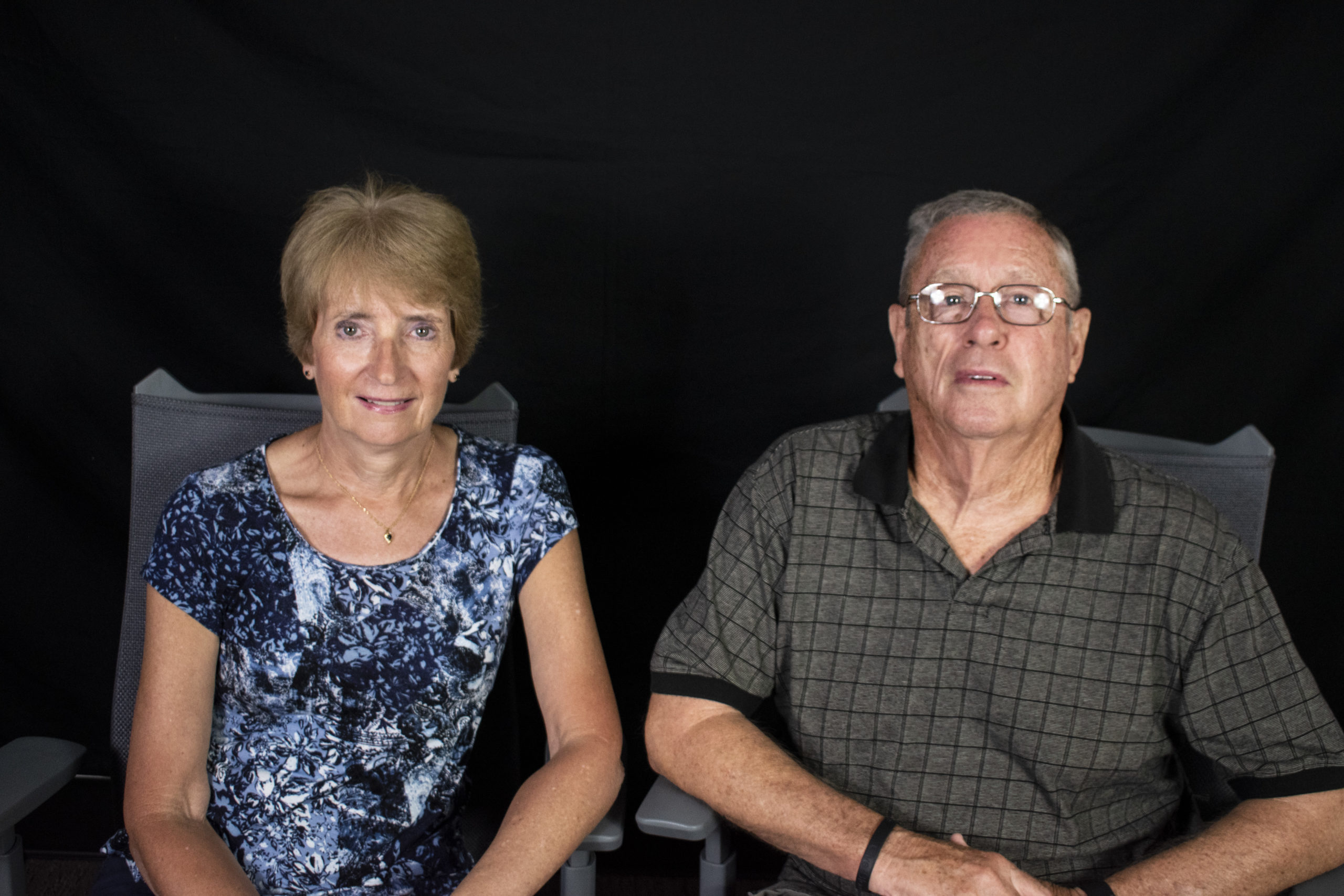 a photo of a man and a woman sitting down and smiling