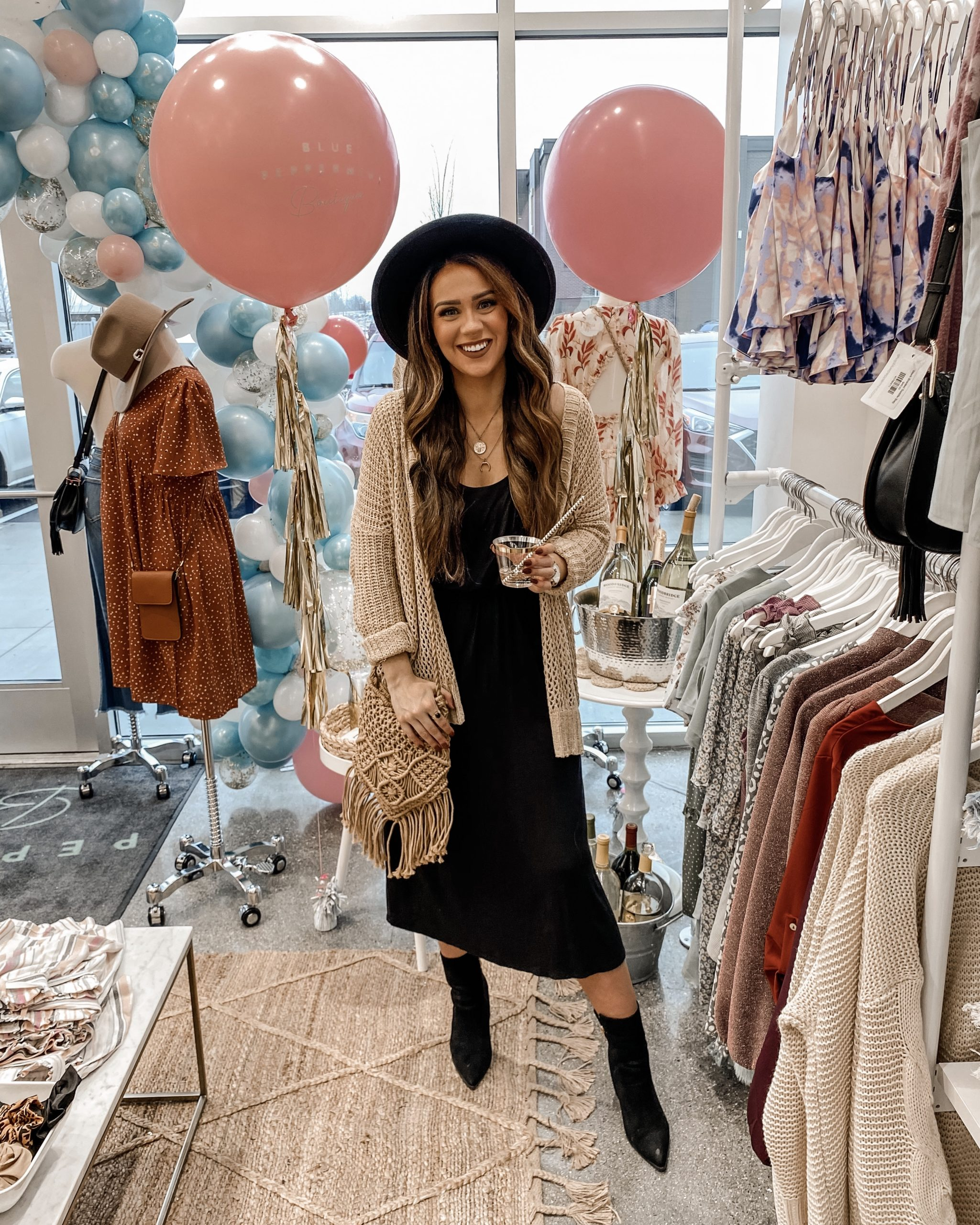 a woman smiling standing inside of a store