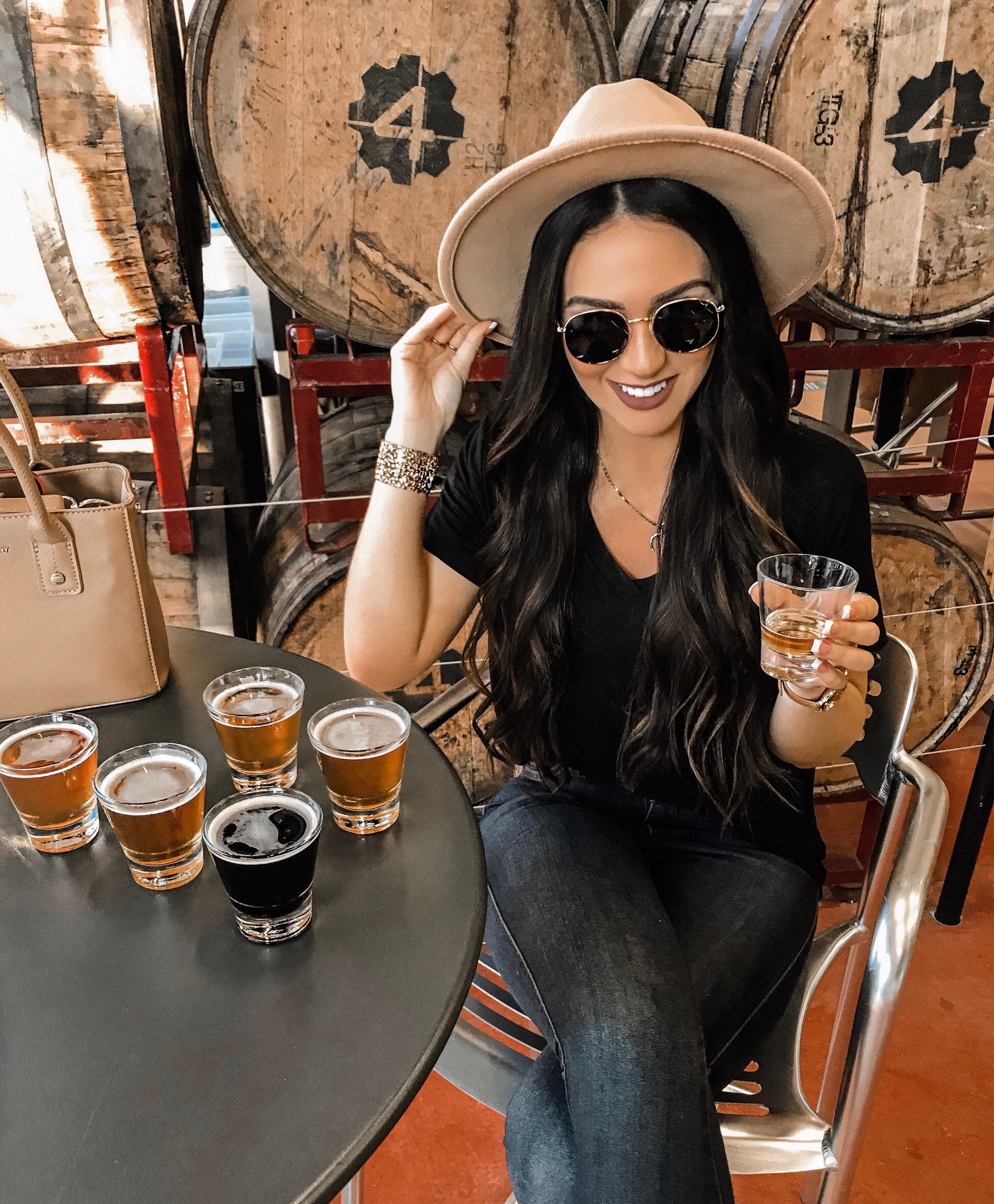 a girl holding a beer smiling