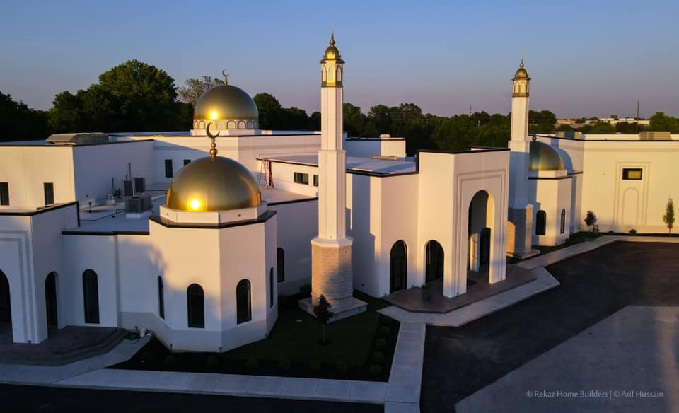 an aerial view of a mosque during sunset