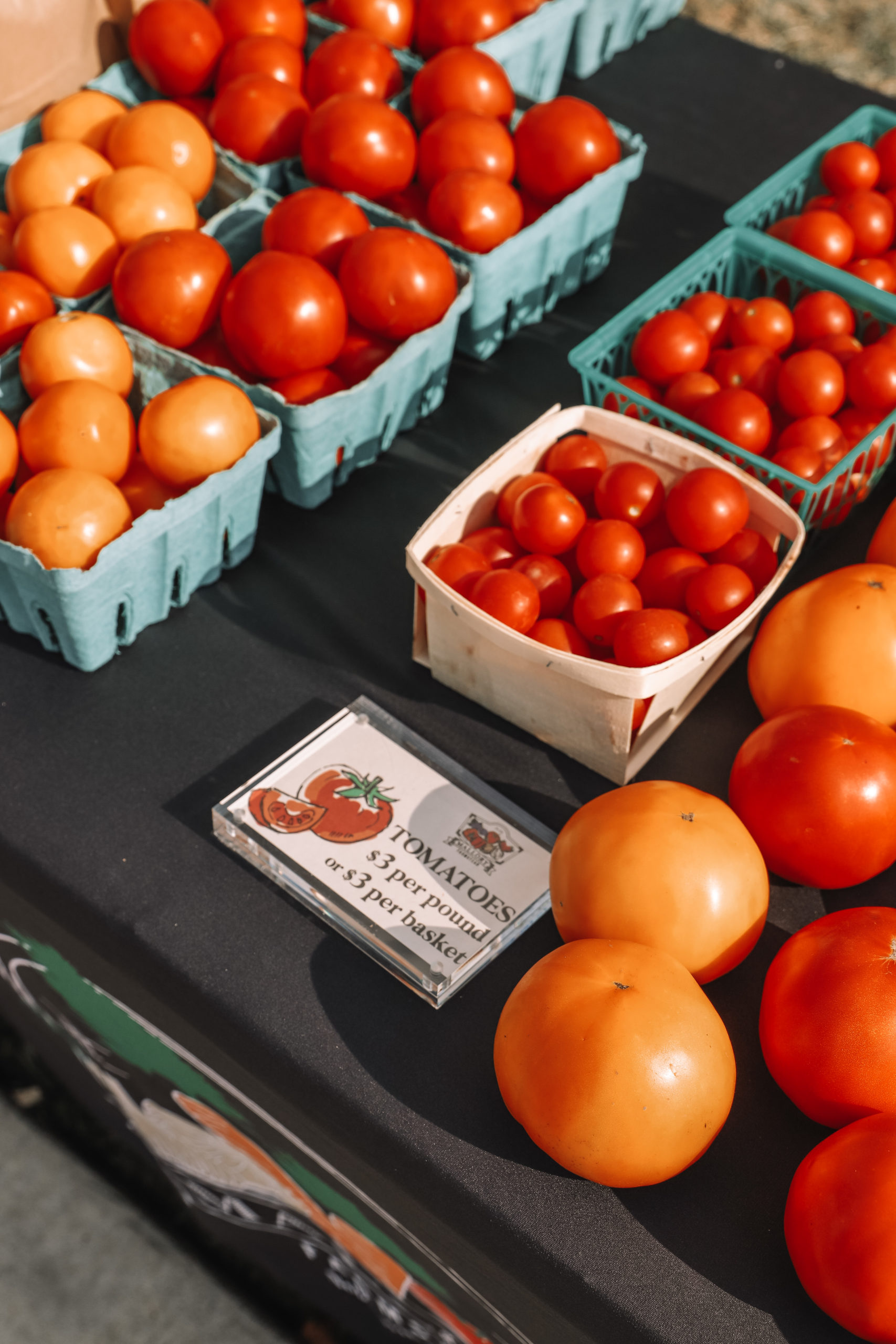 tomatoes on a table for sale