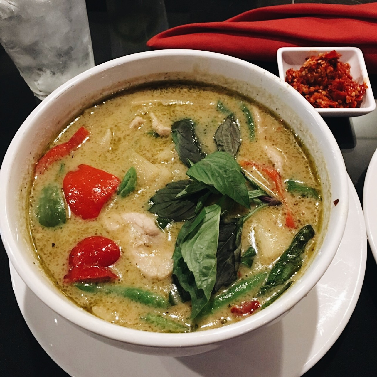 a bowl of green curry