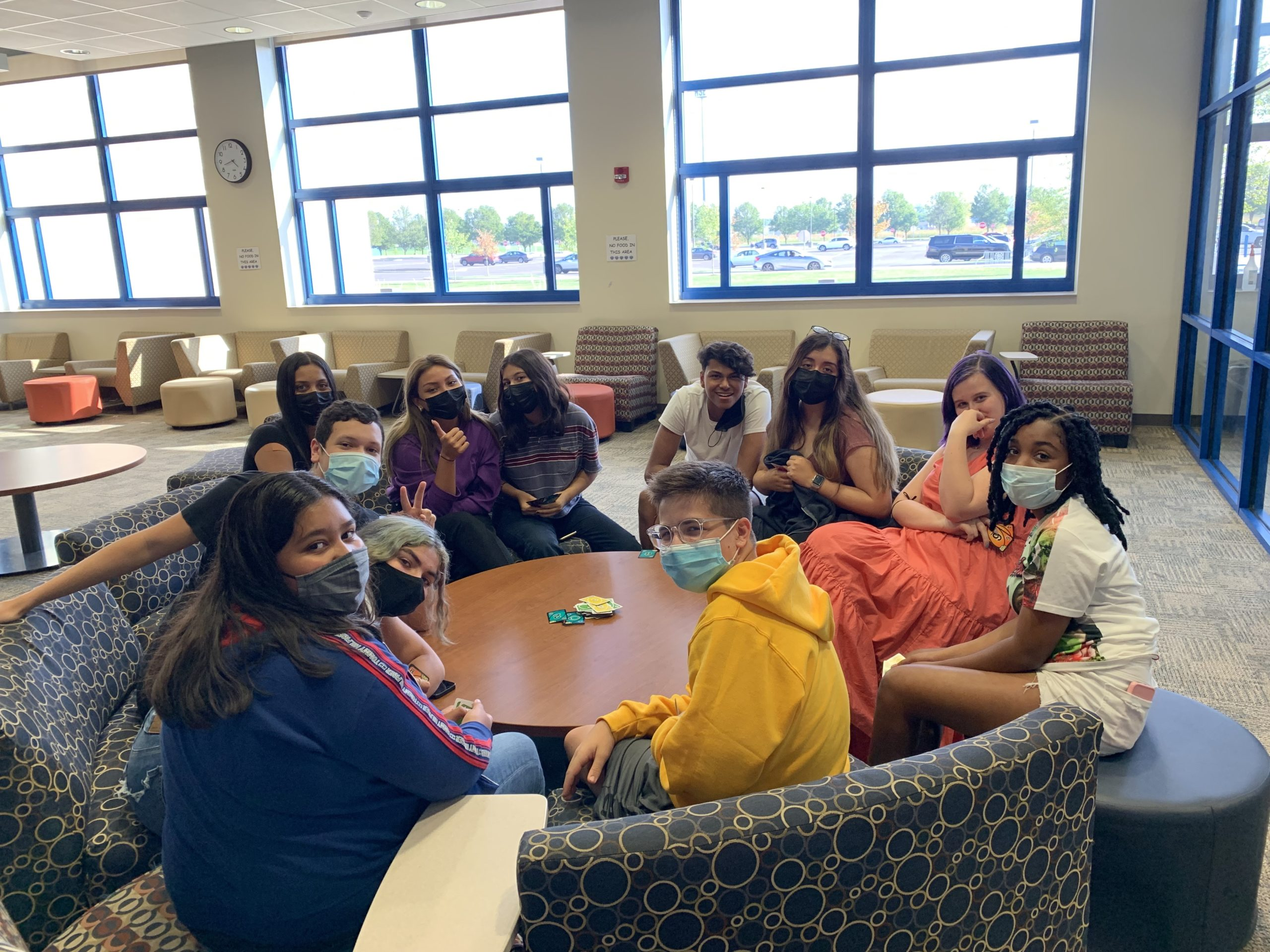 a group of students sitting in a circle and collaborating