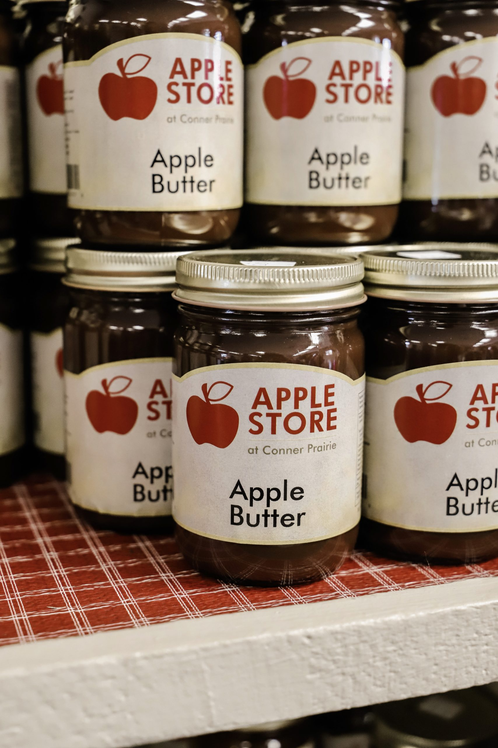 jars of apple butter stacked on each other