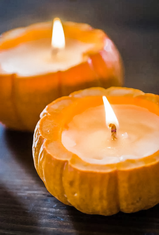 two candles shaped like pumpkins