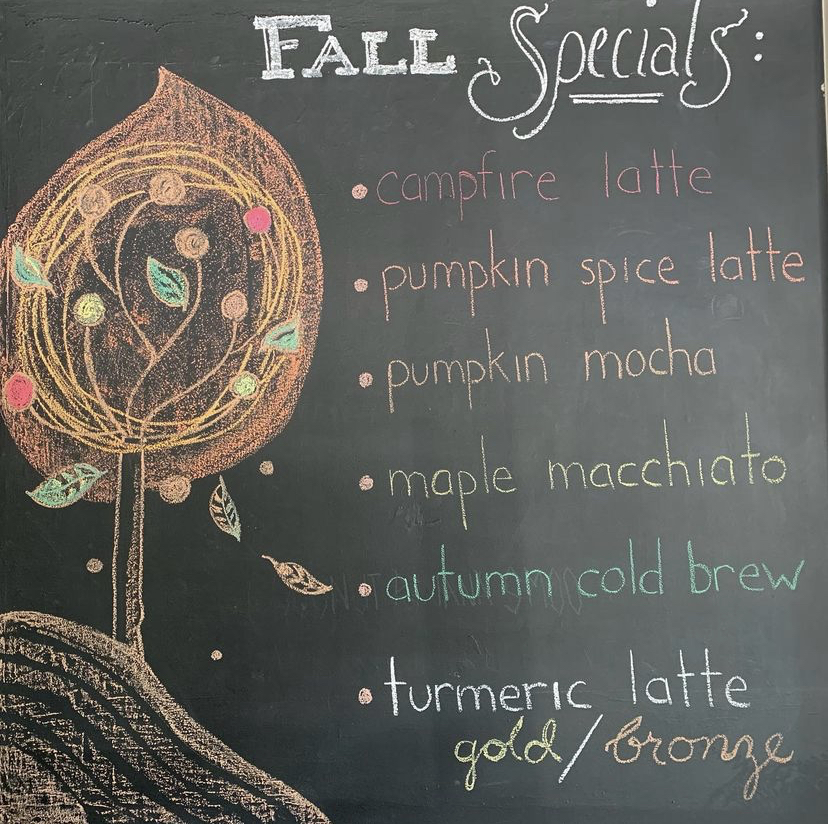 a chalkboard that reads: fall specials: campfire latte, pumpkin spice latte, pumpkin mocha, maple macchiato, autumn cold brew, turmeric latte gold/bronze
